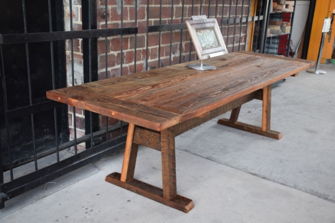 Rustic Farm table constructed of salvaged heart pine with medium finish.
