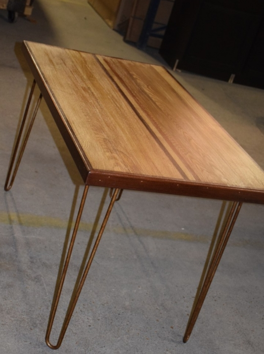 Table from reclaimed piano wood
