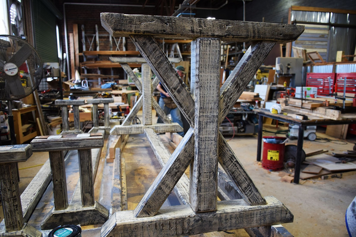 Authentic reclaimed Heart Pine requires little additional 'distressing'