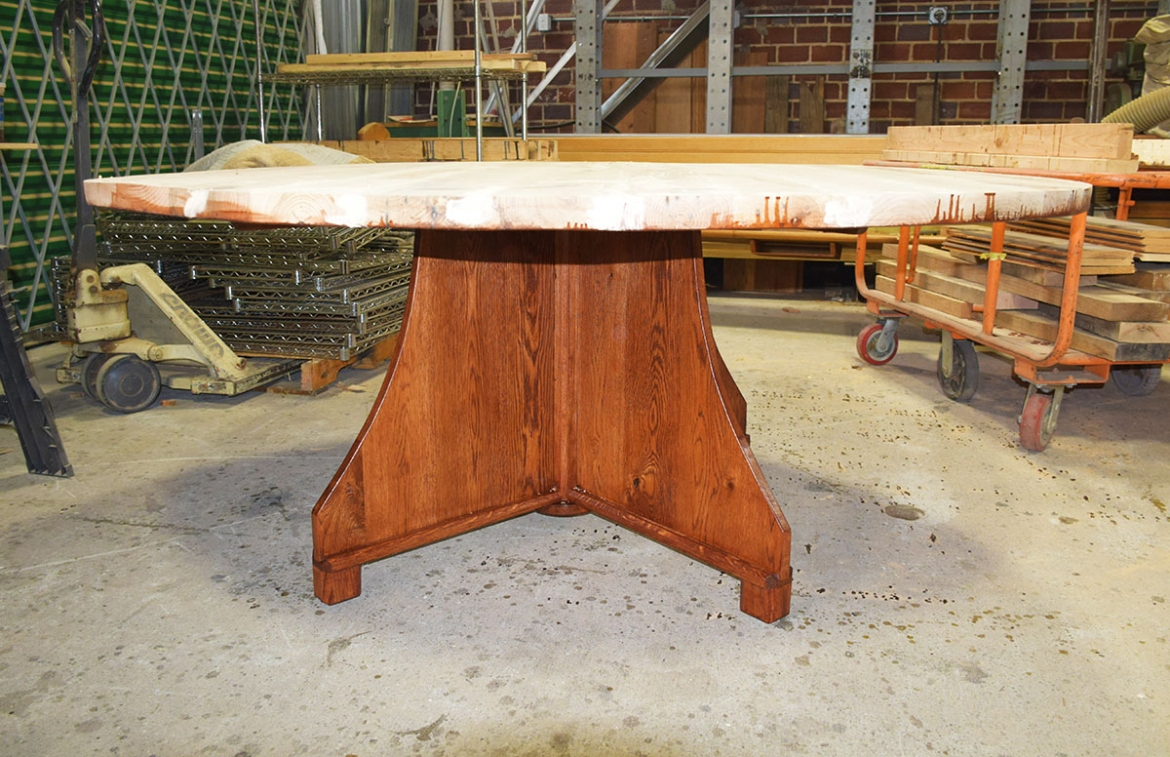 Unfinished table top with finished base attached.
