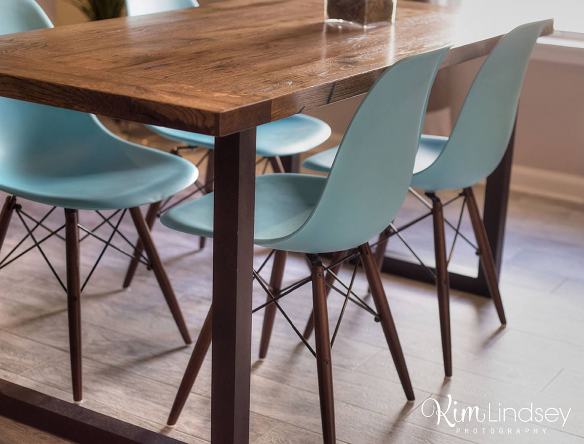 Quaint custom dining table paired with nostalgic chairs.