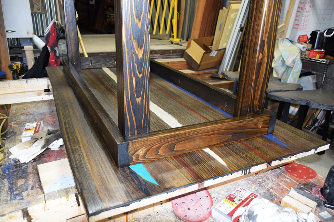 Attaching the table legs and base.