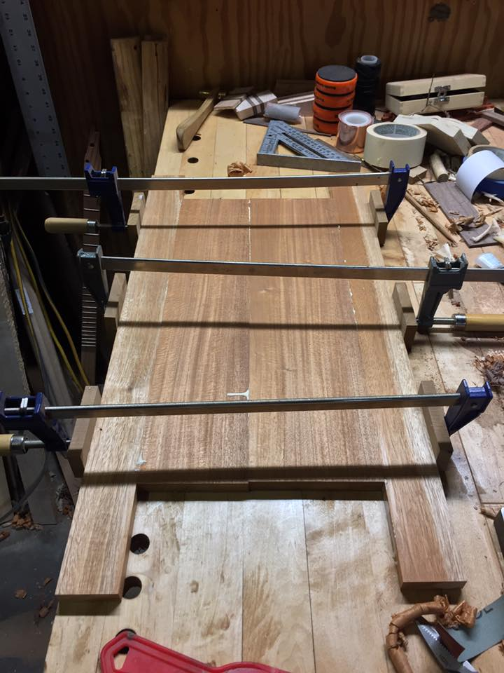 Reclaimed Mahogany boards joined and clamped.
