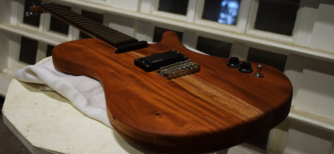 This beautiful hand crafted guitar could be yours!