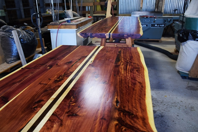 Two ten foot sections of the table after first coat of finish.