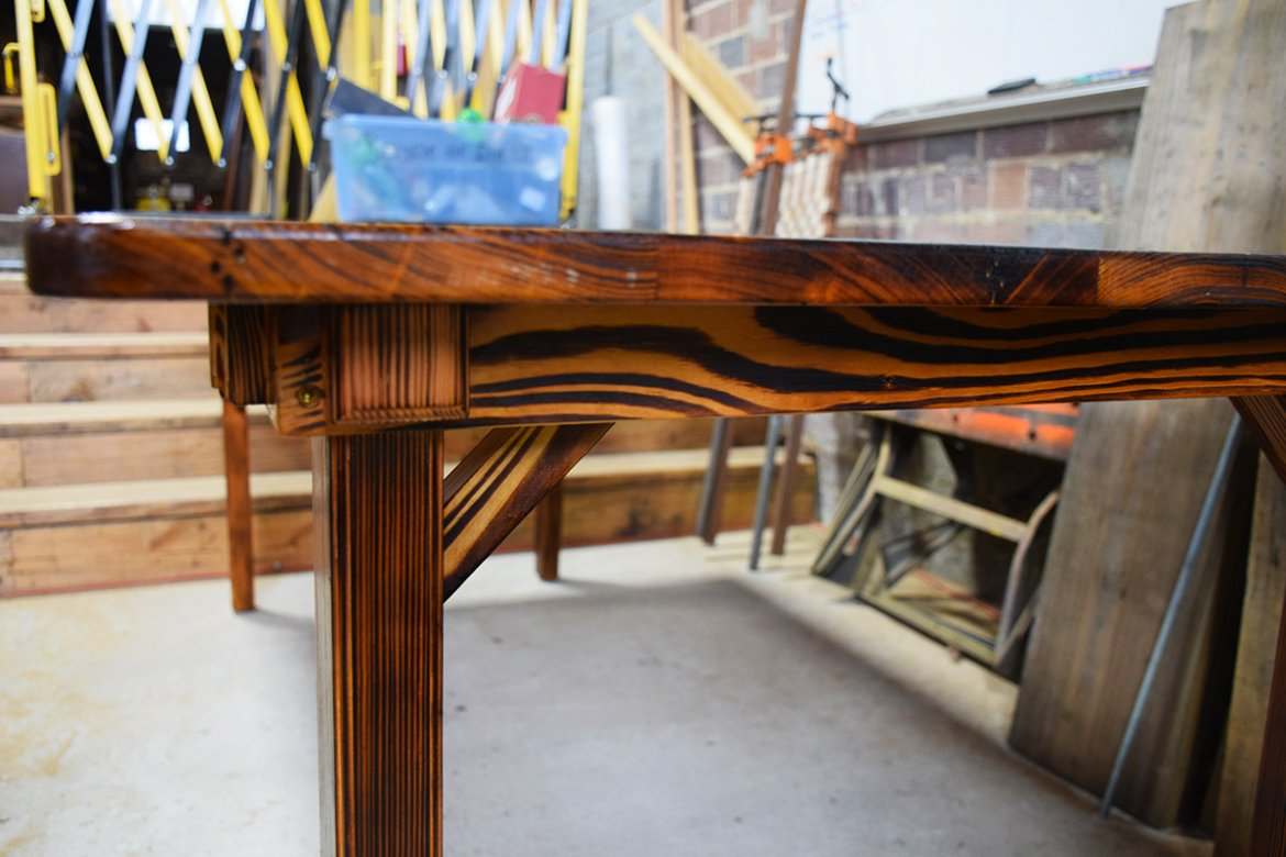 A beautiful Heart Pine farm table that was flamed then coated with a clear urethane finish.