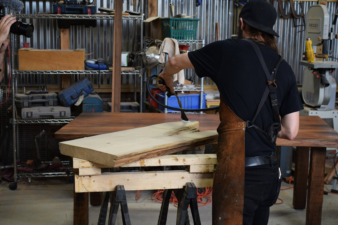 Billy seen here demonstrating the flame technique on a live edge slab.