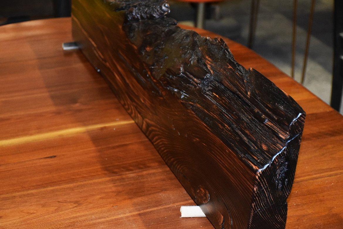Live Edge mantle with a deep, rich look obtained by flaming.