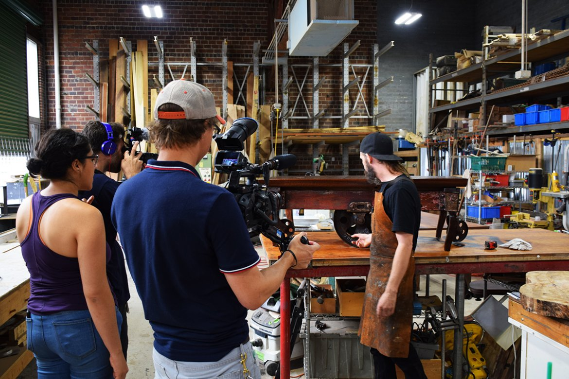 Billy explains the rich history of the Lineberry Factory cart to TV camera crews.