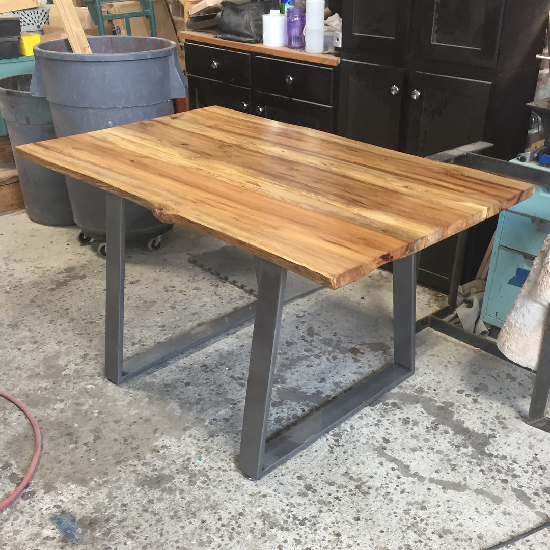 Beautiful Live Edge Sweet Gum table. Legs were fabricated by Main Made Studios.