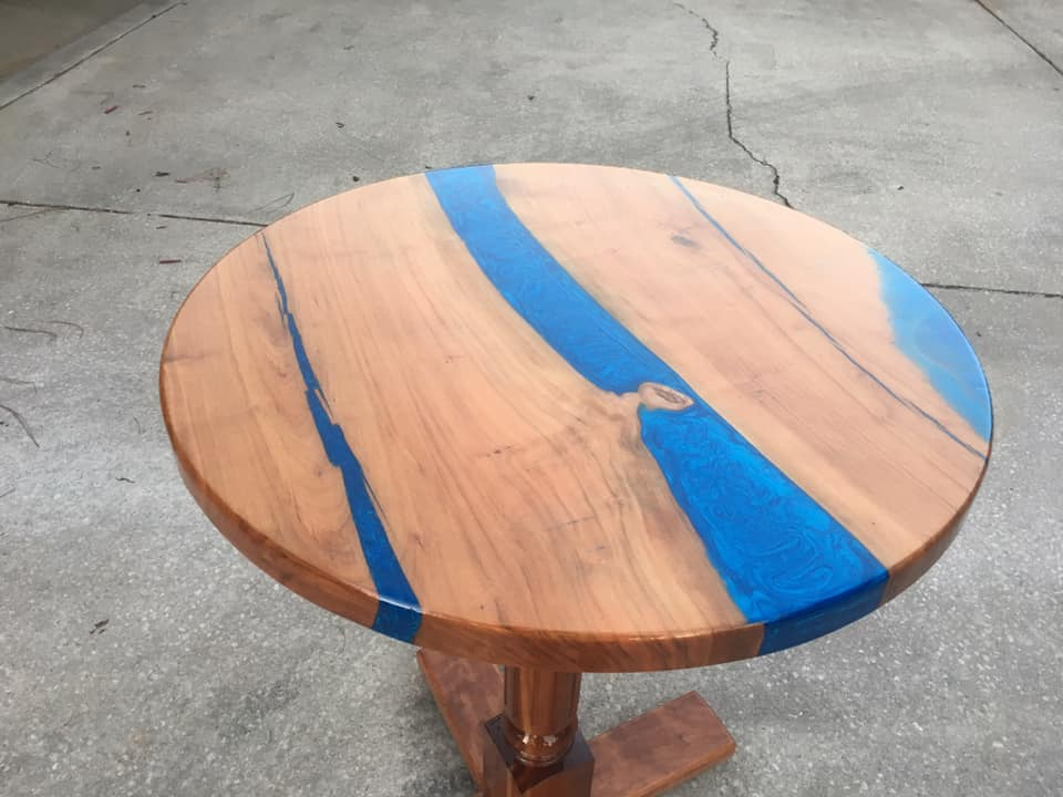 Epoxy River Table made from a single cherry live edge slab.